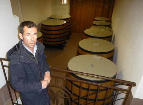 Stéphane Dief with his wooden fermenting vats used for Clos Manou